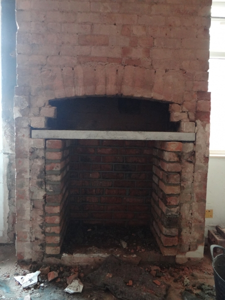 Original bricks restored, new brick surround built and lintel in place