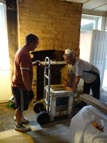 New Firefox 5 multi-fuel stove being brought into place