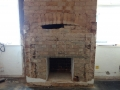 Exposed chimney breast in a Victorian house