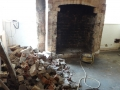 Fireplace broken out and old material removed